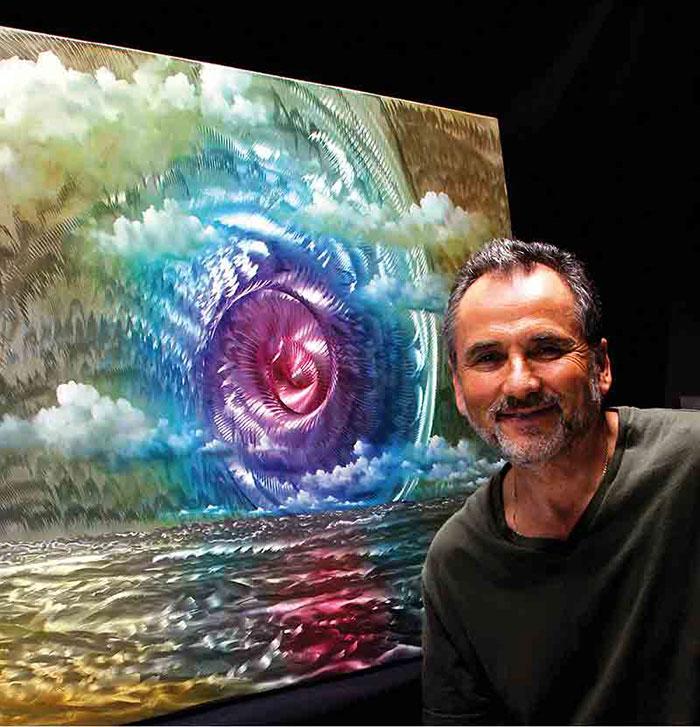 художник на фоне своей картины
